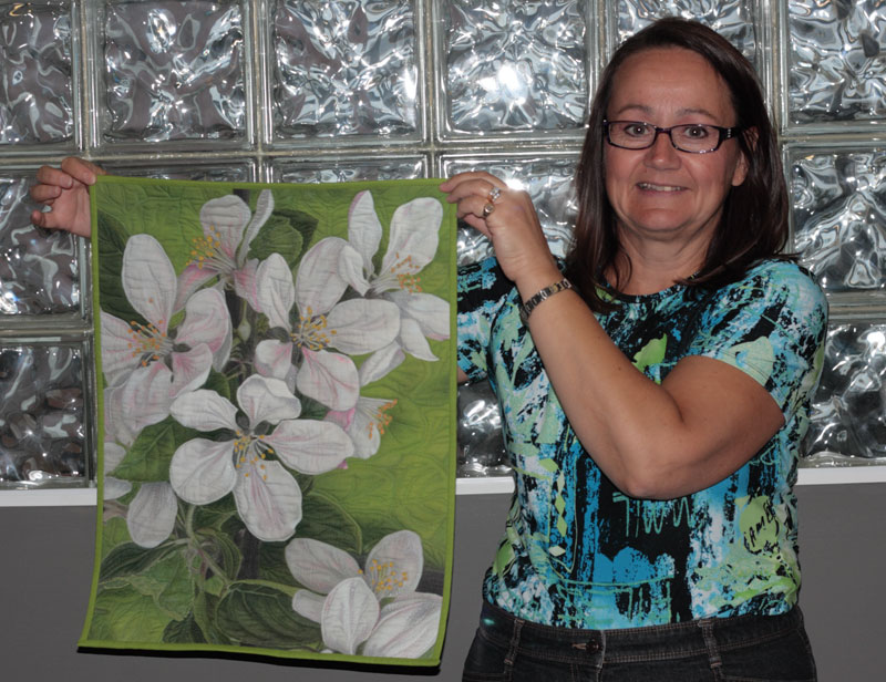 Judy Weiss with piece created from cotton fabric printed by PageMaster