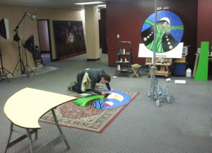 Aaron working on the Grandin Station Mural in the Artstream space