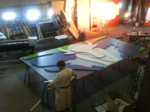 Nick using the large multi-purpose space pre-assembling the mural for Grandin