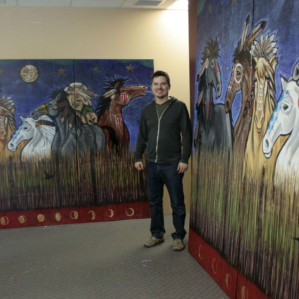 Aaron Paquette with horse print and original