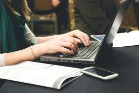 woman typing stock photo
